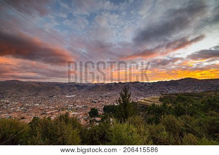 Panoramic View Of Cusco Town With Glowing Cloudscape And Colorful Sky At Dusk. Cusco Is Among The Mo