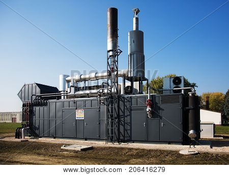 Modern gas engine energy generator with chimney outdoor