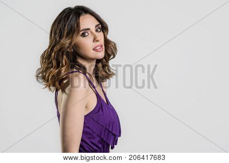 Woman dark brunette long hair. Curly Hair. Fashion Girl With Healthy Long Wavy Hairstyle. Beauty Brunette Woman Portrait