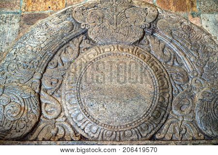 Sandakada pahana also known as a moonstone is a feature of Sinhalese architecture in ancient Sri Lanka. Buddha's Tooth Relic Temple, Kandy
