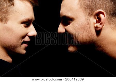 Side view on two screaming men