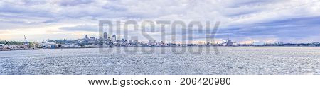 Panorama Cityscape And Skyline Of Quebec City With Saint Lawrence River And Boats During Sunset