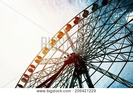 Detail And Silhouette of Ferris Wheel with Sun Set Toned
