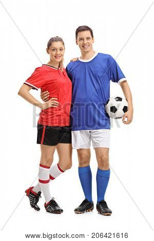 Full length portrait of a female soccer player and a male soccer player with a football isolated on white background