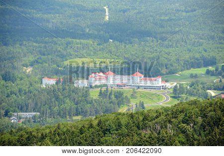 Mount Washington Hotel in summer, from summit of Mount Rosebrook, Bretton Woods, New Hampshire, USA. Now Mount Washington Hotel is registered as a National Historic Landmark.