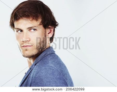 Caucasian Man Wearing White Shirt And Trendy Hairstyle