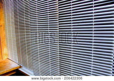 White aluminum horizontal blinds on the Windows closed.