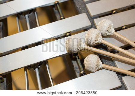 xylophone, music and chromatic instrument concept - closeup on wooden bars with four mallets, glockenspiel, marimba, balafon, semantron, pixiphone, education and orchestra concert use, selective focus