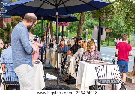 Washington Dc, Usa - August 4, 2017: People Sitting At Outside Area Patio Tables On M Street In Geor