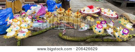 Vendor selling fresh flowers vegetables fruits and umbrella for devotees to bless Hindu god Ganesh at local market on the first day of Ganesh Chaturathi festival
