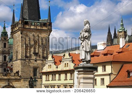 View of Statue of St. Philip Benitius and Lesser Bridge Tower and St. Vitus Cathedral and Cathedral of Saint Nicolas from the Charles Bridge (Karluv Most) in Prague Czech Republic