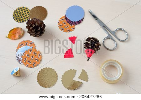 Pinecone hedgehogs. Fall activities for children. Autumn decoration decormadefrom natural materials.