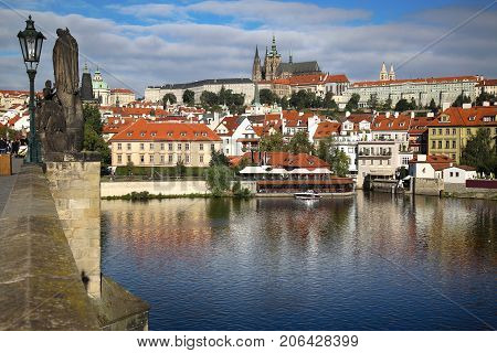 Panoramic view on St. Vitus Cathedral from Charles Bridge with statues on the Bridge Karluv Most in Prague Czech Republic