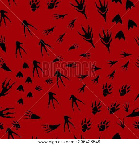 Hand drawn imprint of paws of monsters, seamless pattern traces of paws animals, cartoon style, black silhouette tracks, burgundy background.Vector background extraterrestrial creatures leave a trail.