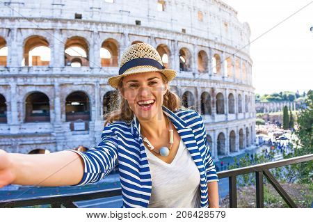 Happy Elegant Traveller Woman In Rome, Italy Taking Selfie