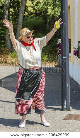 Sainte Marguerite sur Mer France - July 09 2015: Enthusiastic old woman trying to catch the thrown gifts during the passing of Publicity Caravan before the stage 6 of Le Tour de France 2015 on 09 July 2015.