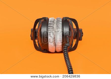 Stereo Headphones On Isolated Orange Background