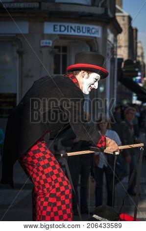 Edinburgh Scotland - August 10 2010: Street artist performing in a street of Edinburgh during the Fringe Festival in Scotland United Kingdom