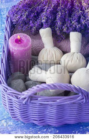basket of thai herbal compress massage - beauty treatment