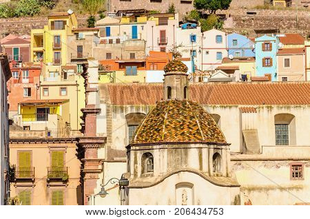 Beautiful colorful dome on the background of colorful buildings of Bosa, Sardinia, Italy