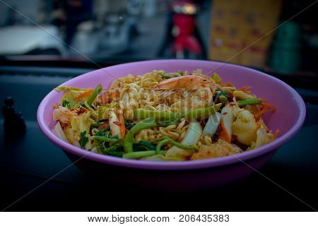 Instant noodle spicy salad with vegetable, prawn, fresh squid