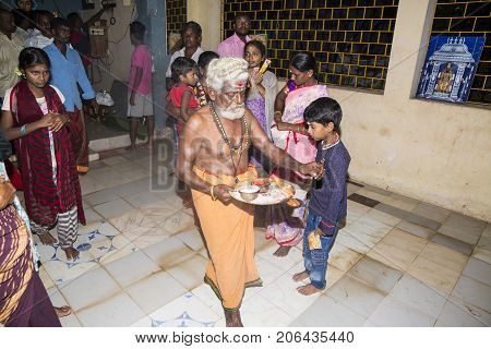 PONDICHERY PUDUCHERY INDIA - AUGUST 26 2017. Devotees around ganesha statue ceremony of offerings ganesha festival