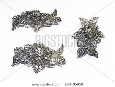 beautiful openwork silver hairpin with three camera angles on a white background