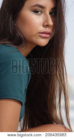Serious Youthful Person with Long Brunette Hair