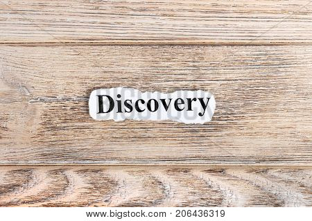 Discovery text on paper. Word Discovery on torn paper. Concept Image. poster