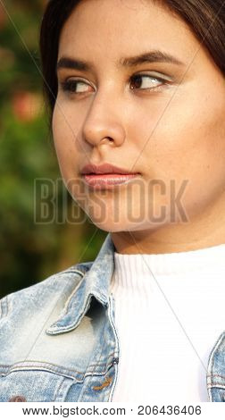 A Girl Staring Wearing a Denim Jacket