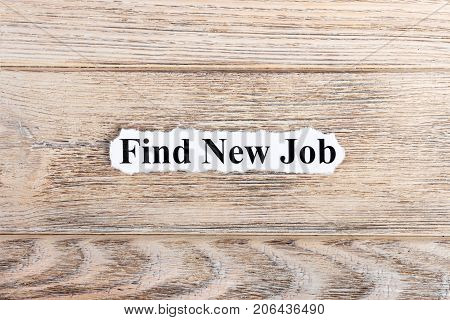 find new job text on paper. Word find new job on torn paper. Concept Image.