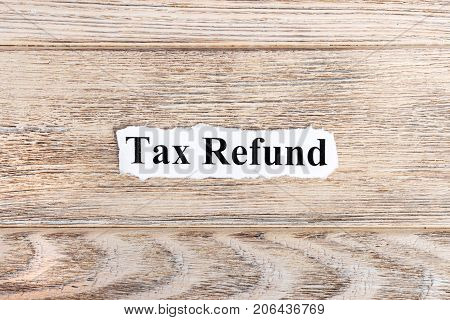 tax refund text on paper. Word tax refund on torn paper. Concept Image.