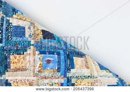 interior, decoration, handmade, design, sewing concept - there is one corner of multicolored blanket like puzzle made of little rags with folksy patterns and white space for lettering