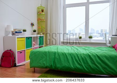 interior, home and furnishing concept - kids room with bed, other furniture and accessories