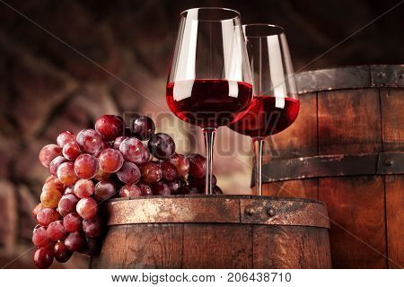 Red Wine.still Life Two Glasses Of Red Wine, Grapes And Barrel.selective Focus.wine Cellar Atmospher