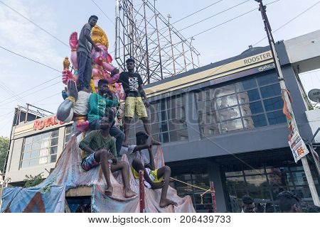 PONDICHEY PUDUCHERY INDIA - AUGUST 29 2017. Devotees bring Loard Ganesha from workshop for procession with large crowds during Hindu Lord Ganesha chaturathi festival along the street