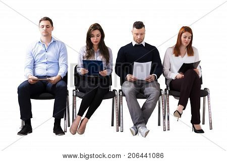 Young Business People Waiting For Job Interview Against White Background