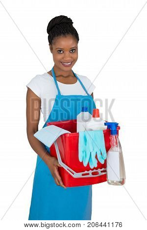 Portrait Of Smiling Female Janitor With Cleaning Equipments Against White Background