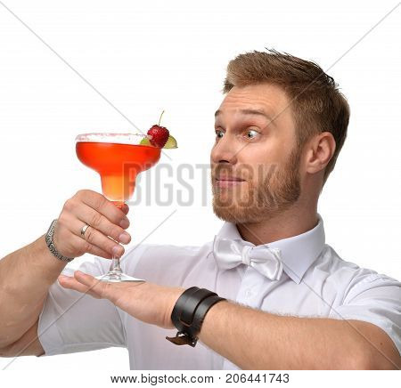Bartender men with red margarita cocktail with strawberry and lime happy looking at the glass isolated on a white background