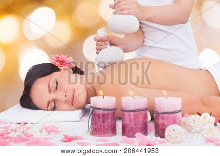 Close-up Of A Relaxed Woman Receiving Massage With Herbal Compress Balls In Spa