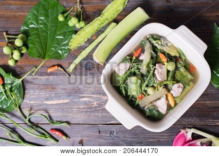Northern Thai food (Kaeng Khae with pork),curry is made mainly with vegetables and herbs,main ingredients is Piper sarmentosum leaves.Top view of food