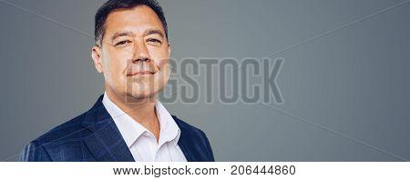 Leadership.attractive Business Man Looks Confident ,studio Portrait. Mature And Beautiful. Panoramic