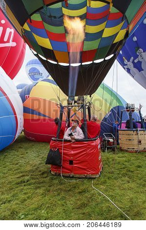 Bristol, UK: August 14, 2016: Inflating the balloon at the Bristol International Balloon Fiesta. The annual event has become Europe's largest hot air balloon festival.