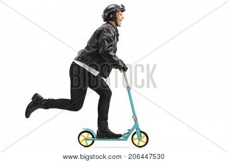 Full length profile shot of a biker riding a scooter isolated on white background