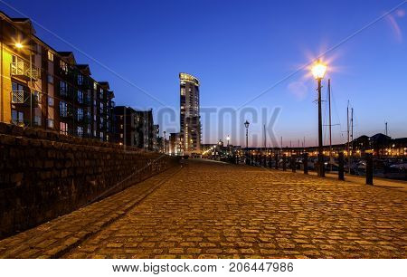 Swansea Marina's Meridian Tower at night from the cobbled streets by the harbor. SA1's residential district.