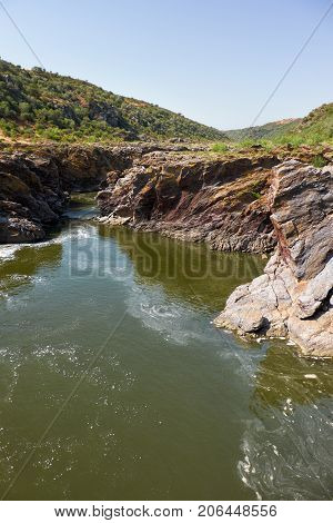 Pulo Do Lobo Or Wolf's Leap Waterfall And Cascade On River Guadiana, Alentejo, Portugal