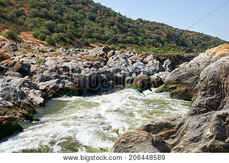 Pulo do Lobo or wolf's leap waterfall and cascade on river Guadiana in vicinity of Mertola Alentejo Portugal