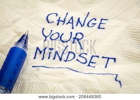 Change your mindset advice or reminder - handwriting on a napkin