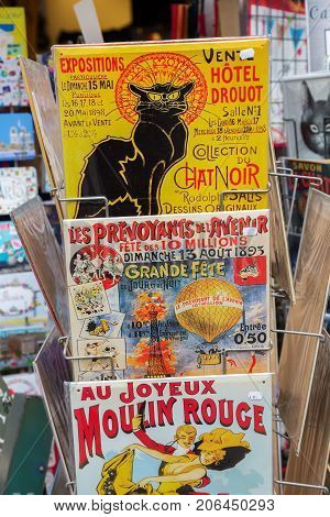 Paris France - October 16 2016: vintage advertisement panels at souvenir shop in Paris. Paris is the capital of France and one of Europes major finance commerce fashion science and arts centers
