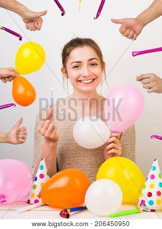 party, surprise, happiness concept. magnificent young girl with big charming smile and funny wrinkles in the cornerns of the eyes, she is celebrated her birthday and everybody congratulates her